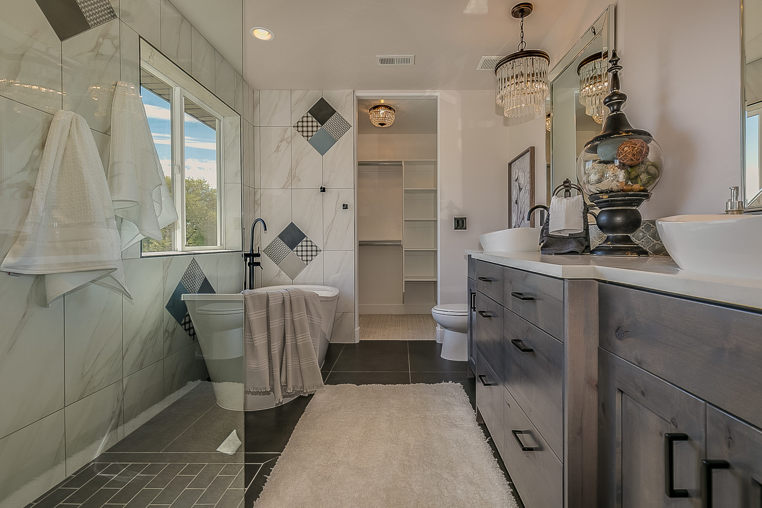 Double vessel sinks add trendy design to upscale bathroom